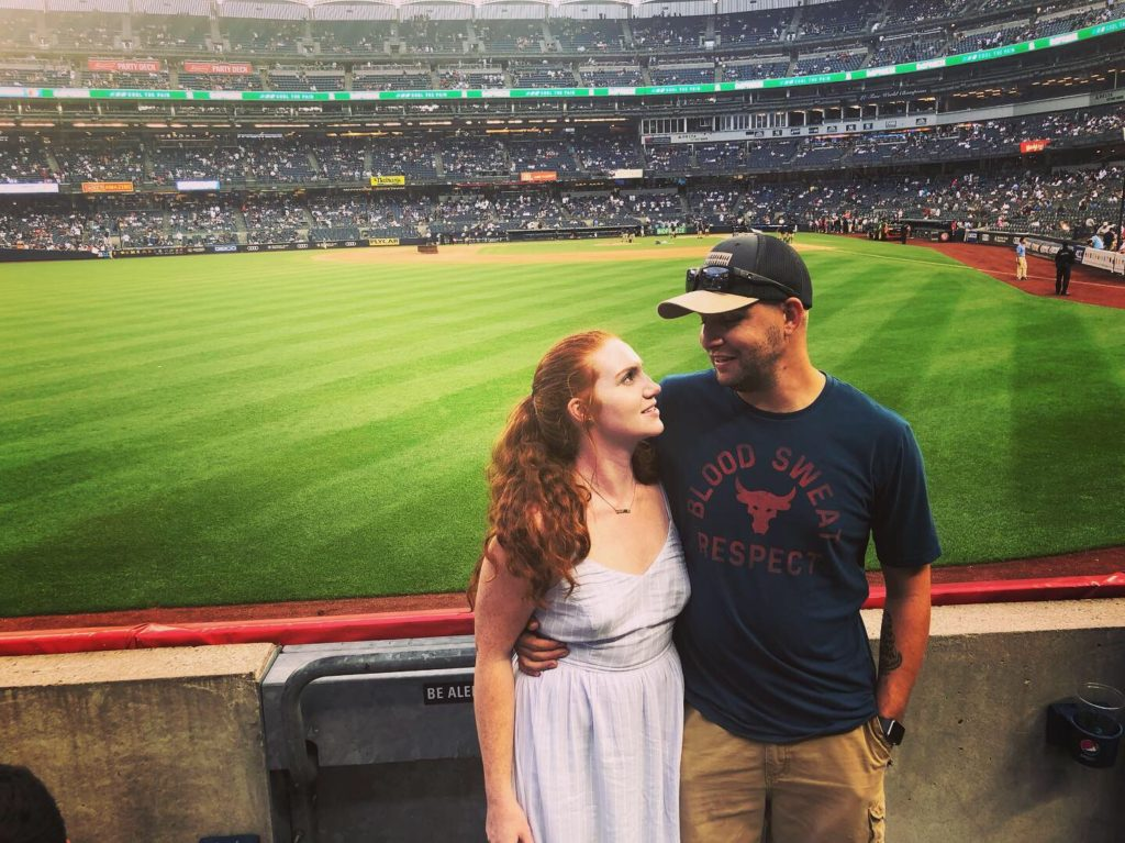 Carrie and her boyfriend at a Yankee's game